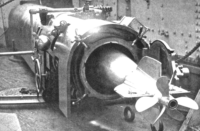 A British whitehead torpedo in its tube.