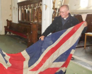 A dusty job. Peter Sutton giving me a hand packing the flag