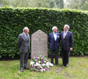 Three grandsons meet. Richard Latham and Nick Jellicoe are grandsons of Admiral Jellicoe. Max Schultz's grandson, Jürgen, stands between us his grandfather's memorial stone in Wilhelmshaven.