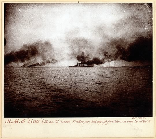 HMS Lion hit on Q turret.Destroyers taking up position in van to attack.