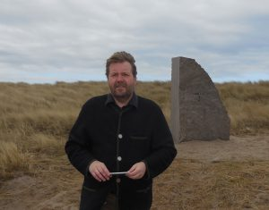 Dr. Stefan Huck,  Director, German Naval Museum, Wilhelmshaven. He stands in front of the stone for the torpedo boat,  V.4., the last Jutland wreck found. In March 2016.